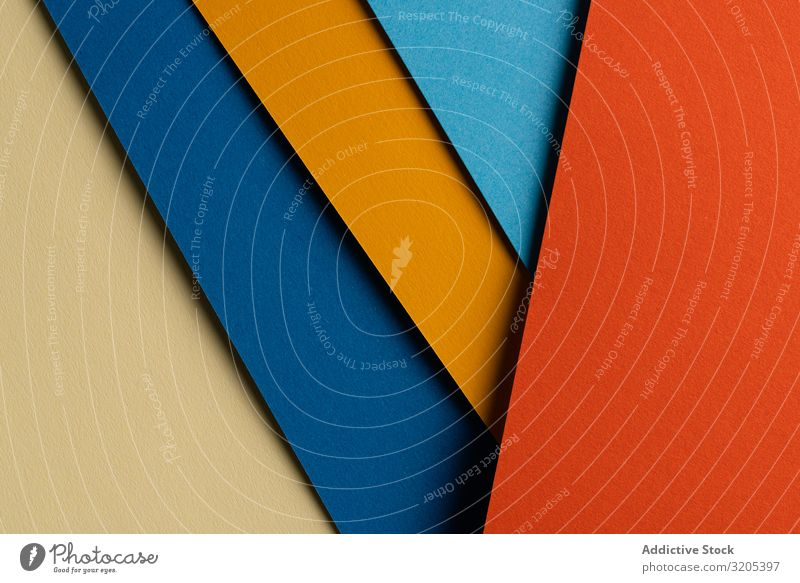 Arranged sheets of colorful carton layout blue orange background tone blocking shade cardboard surface material design texture trend simple minimalist paper
