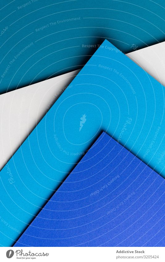 Arranged sheets of colorful carton layout blue white background tone blocking shade cardboard surface material design texture trend simple minimalist paper