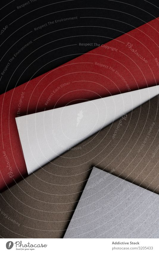 Arranged sheets of colorful carton layout black brown red white glitter background tone blocking shade cardboard surface material design texture grey trend