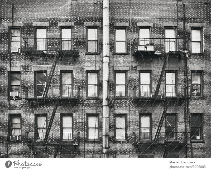 Old brick house with fire escapes, New York, USA. Lifestyle Living or residing Flat (apartment) House (Residential Structure) House building Building