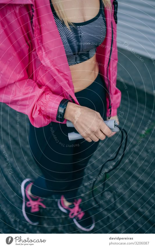 Young woman with sportswear and jump rope Lifestyle Style Personal hygiene Health care Leisure and hobbies Sports Human being Woman Adults Sneakers Fitness Jump