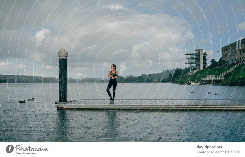 Sportswoman looking lake from pier Lifestyle Style Body Calm Human being Woman Adults Landscape Clouds Rain Coast Lake Building Sneakers Fitness Authentic Thin