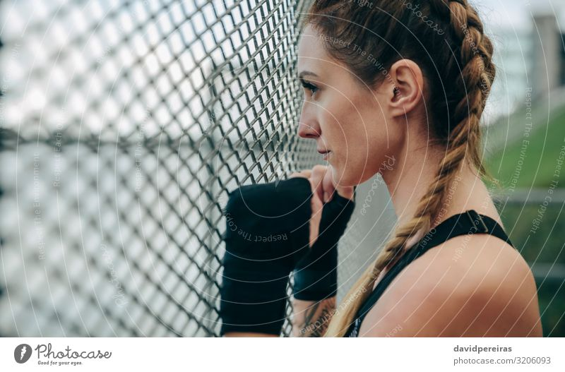 Sportswoman looking through a fence Lifestyle Beautiful Body Face Leisure and hobbies Human being Woman Adults Hand Clouds Gloves Fitness Authentic Strong Brave