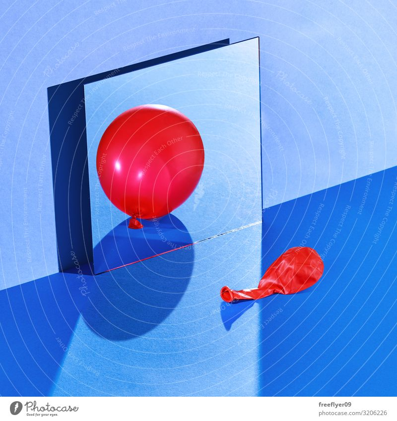 A balloon reflecting itself with a wrong reflection Table Mirror Fashion Balloon Glittering Blue Red Still Life Hard light wall square squareformat cold empty
