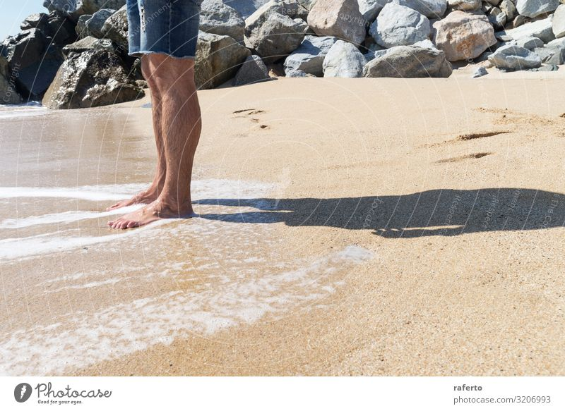 Low angle view of young man standing with bare feet on beach Body Relaxation Freedom Summer Beach Ocean Human being Man Adults Feet Nature Sand Coast Stand Wet
