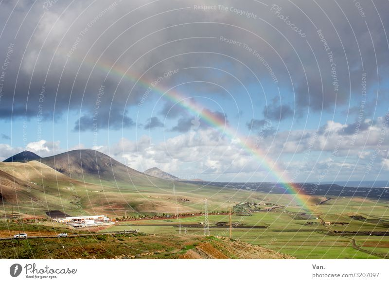 Rainbow over hilly landscape hillock mountains Sky Clouds Raincloud Landscape Nature wide Smooth green Blue