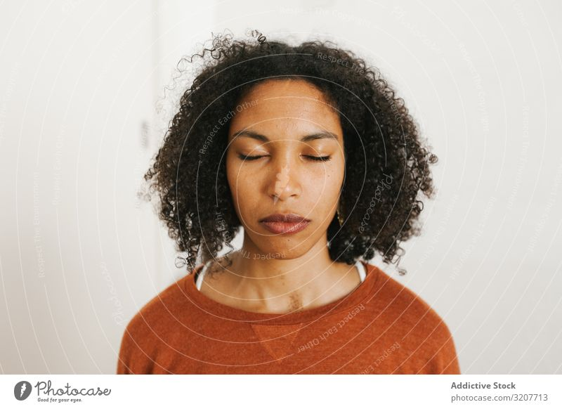 Portrait of young black woman with closed eyes meditation practicing relaxation beautiful female meditate wellness slim spirituality wellbeing attractive mind