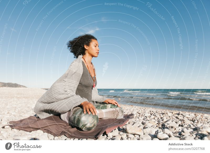 Sportive woman sitting on sandy beach in asana meditating practicing yoga position relaxation exercise beautiful fitness sport leisure female workout meditate