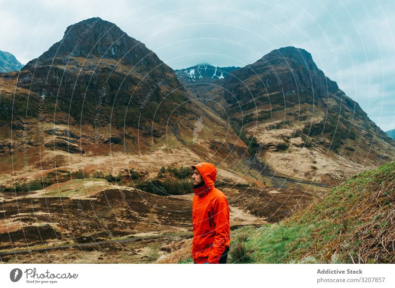 Man standing against picturesque landscape man mountain wind hoodie scotland raining coat nature cold travel view valley beauty freedom male adventure trekking