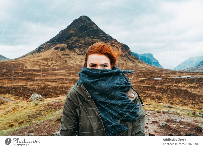 Redhead woman in scarf against mountains wind scotland ginger redhead nature cold landscape travel covered view valley beauty freedom adventure young beautiful