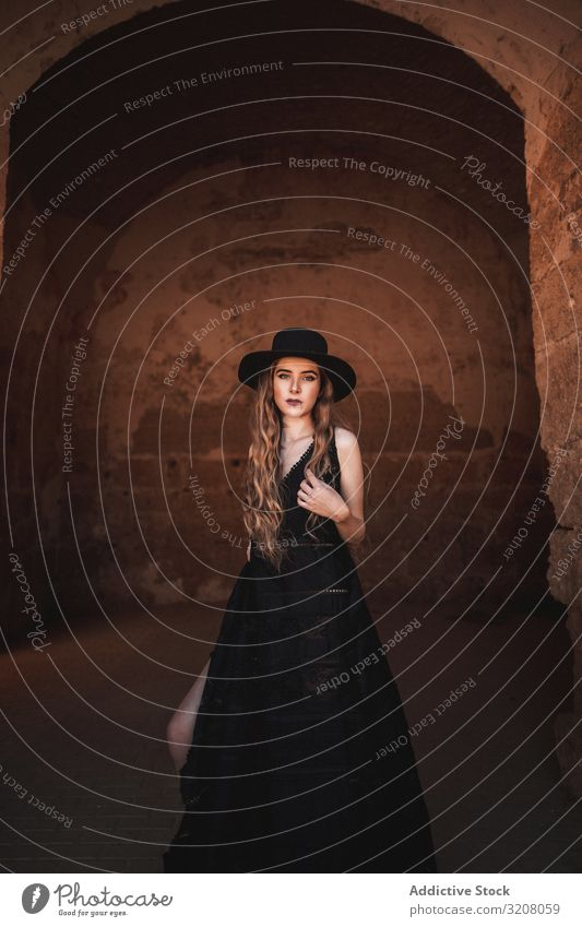 Elegant female in ancient fortress woman fashion stylish trendy glamorous model dress black clothing castle young beautiful pretty attractive elegant