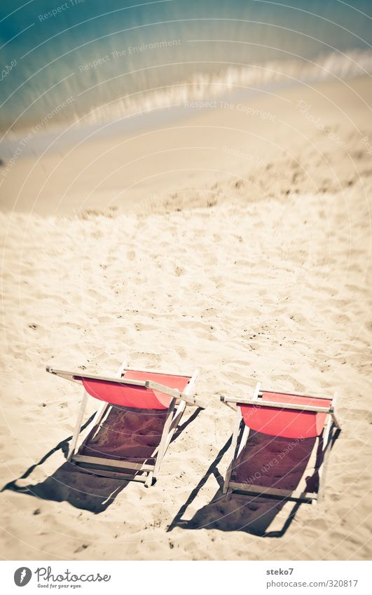 wait for the 2nd Advent Sun Waves Beach Ocean Relaxation Warmth Red Turquoise Calm Vacation & Travel Deckchair Empty Summer vacation Colour photo Exterior shot
