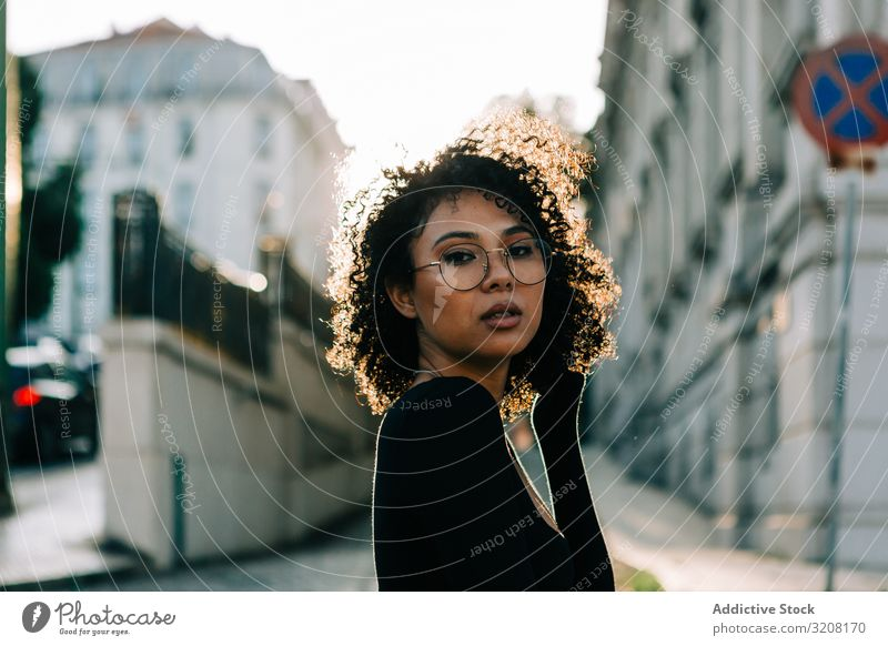 Attractive ethnic female in city street woman fashion stylish trendy clothing glamorous traffic car stop sign young african american casual beautiful pretty