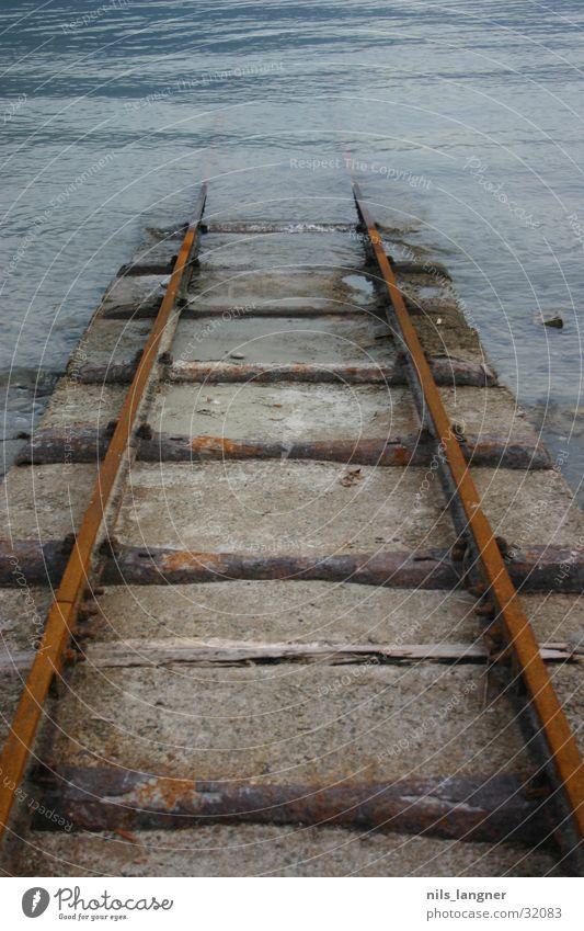 Water Dark Wood Transport Railroad Rust Downward Go under Underwater photo Ascona