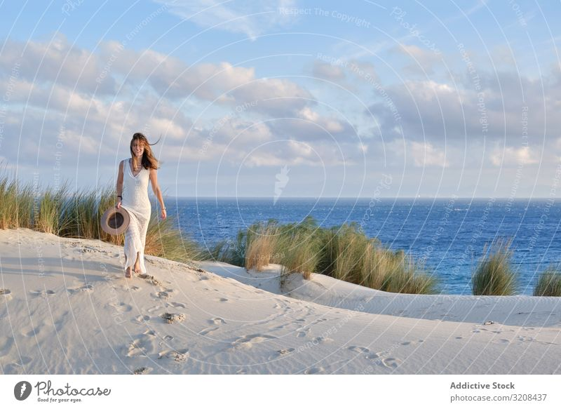 Woman walking sandy hill woman picturesque motion energy summer landscape dune desert scenic sunset tarifa cadiz spain nature female travel vacation tourism