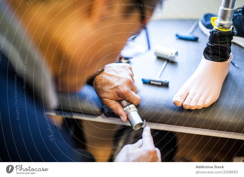 prosthesis workshop worker imitation adjusting medicine artificial object industry ankle healthcare made man limb single foot human technician adjustment clinic
