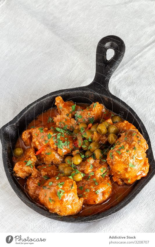 Cast iron pan with meatballs peas food delicious cooked tasty homemade vegetable gourmet green cast skillet black appetizer cuisine meal dinner dish healthy