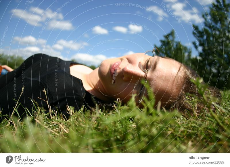 lake park Meadow Woman Black Green Sea park Sleep Clouds Grass Upper body Sky Freiburg im Breisgau Contentment Happy Laughter Blue Face