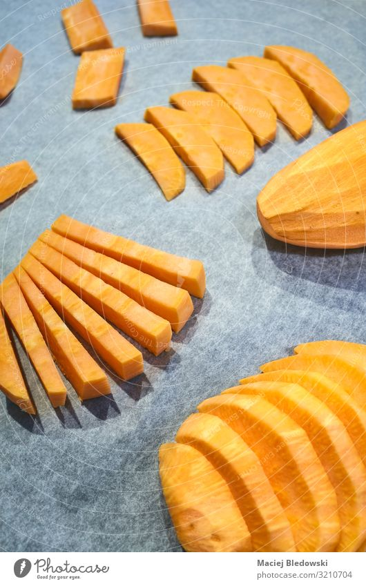 Fresh sweet potatoes on baking paper. Vegetable Nutrition Lunch Dinner Vegetarian diet Diet Slow food Finger food Healthy Eating Paper Natural Potatoes Cut