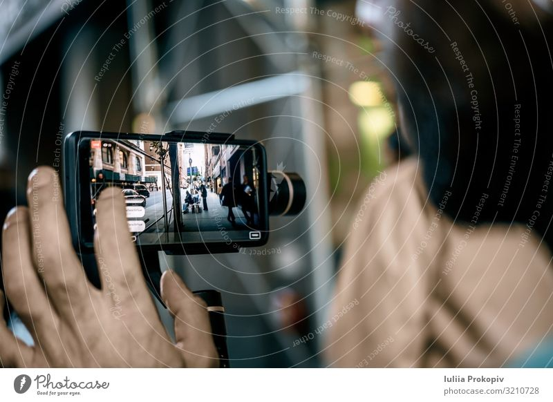 Man doing live video with phone with stabilizer in NY Lifestyle Telephone Camera Adults Street Vacation & Travel device mobile Video gimbal Tripod record movie