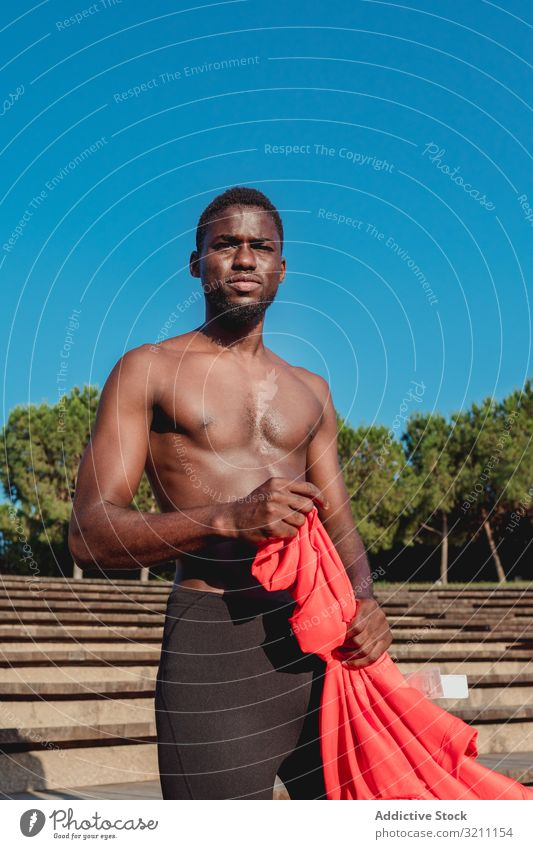 Black man with shirtless torso on street sport strong lifestyle athletic summer male muscular heat ethnic leisure african american black healthy athlete jogger