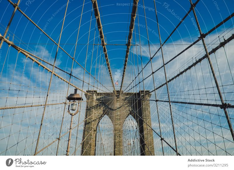 brooklyn bridge view from below with a blue sky background america american city nyc manhattan york cityscape urban architecture travel usa landmark skyline new