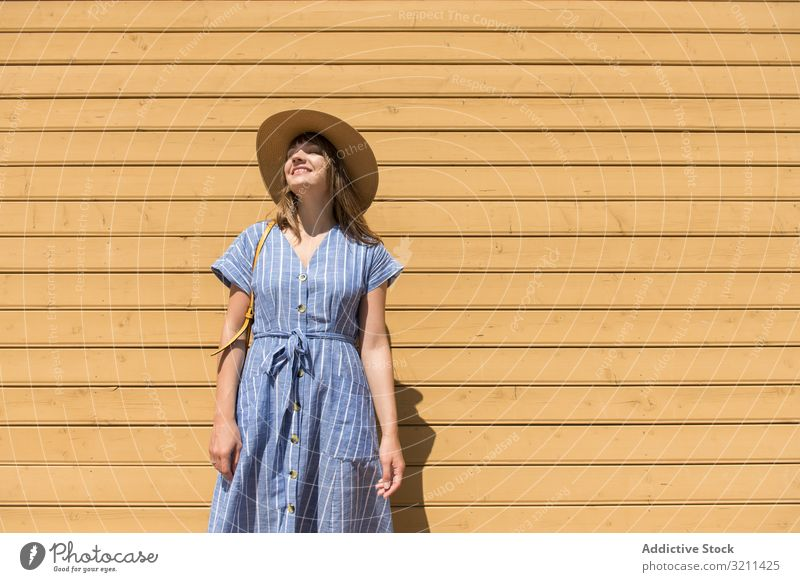 Young woman enjoying sunshine in summertime freedom smiling straw hat pretty weekend tourism carefree content delighted young adult vacation happiness beautiful