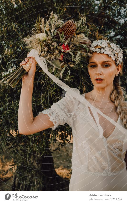 Woman in dress with flower bouquet woman bride boho lace wreath beautiful style tender sensual natural summer romantic wedding blonde hippie nature female hair