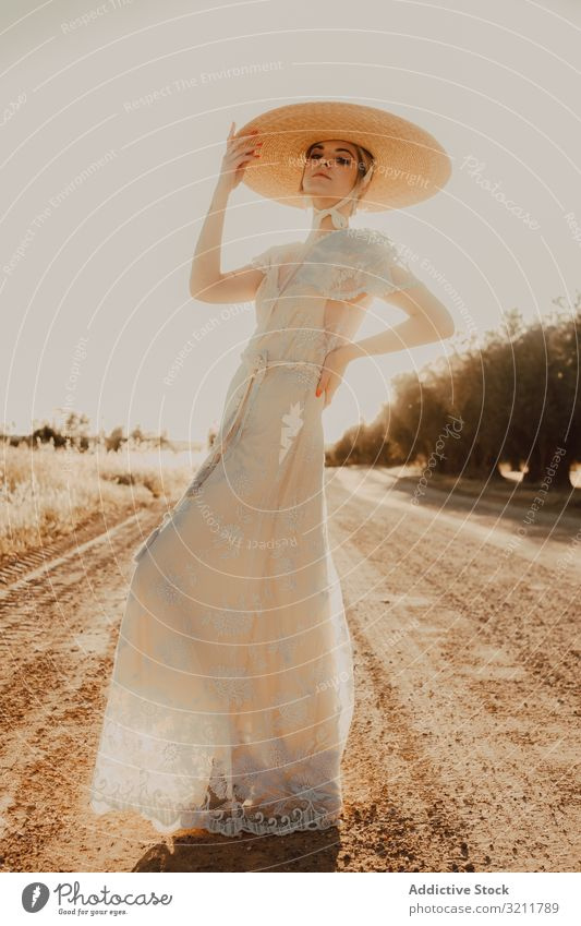 Beautiful stately woman in hats in bright sunny day bride wreath flower wedding beautiful style natural summer blonde hippie lifestyle nature dress hair fashion