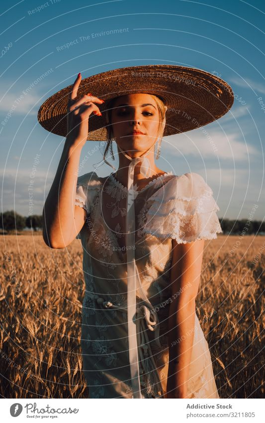 Woman in big round hat in middle of wheat field woman boho lace beautiful style tender bride sensual natural summer romantic wedding blonde straw hippie