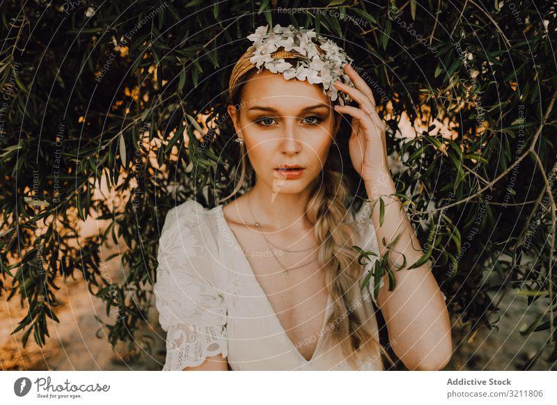 Charming woman in elegant dress near tree bride boho lace wreath flower dream style tender sensual natural summer romantic wedding blonde hippie lifestyle