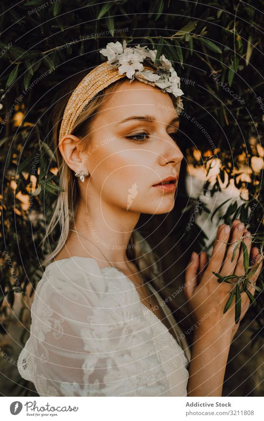Charming woman in elegant dress with flowers near tree bride boho lace wreath dream style tender sensual natural summer romantic wedding blonde hippie lifestyle