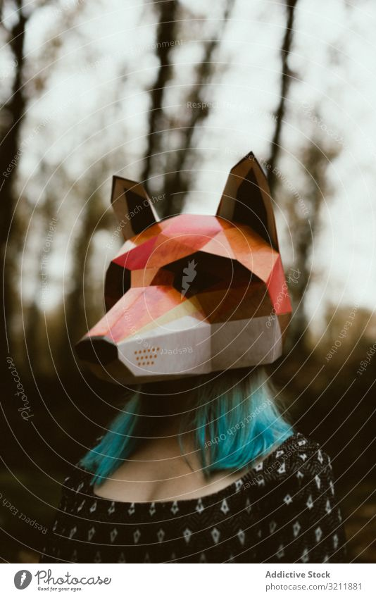 Woman in red fox mask walking in forest woman autumn mysterious overcast wildlife habitat protection endangered female impact fragile loss animal threat