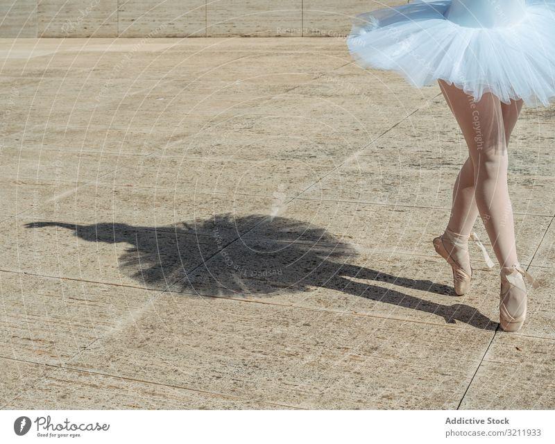 Ballerina standing on tiptoe classical position outside ballerina shadow dance elegance dancer flexibility ballet posing exercise beautiful woman balance female