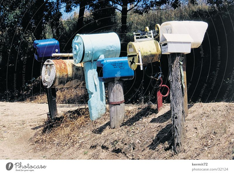 You have mail Mail Mailbox Communicate Australia Wooden stake plastic barrels metal drums snail mail Card postal delivery Rural Loneliness Colour photo