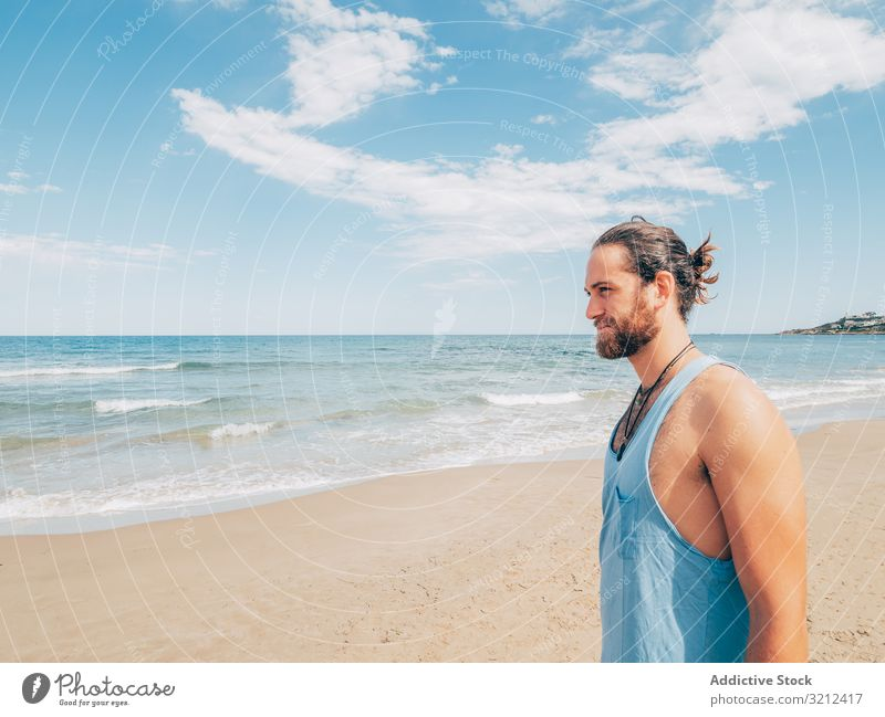 Man standing on the beach man rest calm relaxed resort harmony summer beard hobby vacation active ocean resting male travel happy handsome attractive adult
