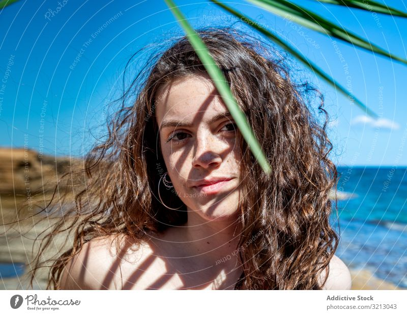 Beautiful female on sea background woman seashore summer beach vacation recreation resort travel trip adventure tourism holiday ocean young person attractive