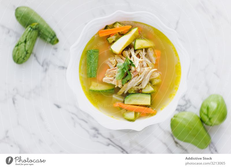 Served chicken soup with carrot and zucchini bowl delicious served food meal gourmet cuisine nutrition dinner vegetable plate tasty diet health dish culinary