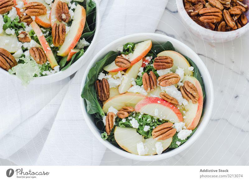 Served apple salad with pecan delicious served food meal gourmet cuisine nutrition dinner spice fruit vegan vegetarian plate bowl tasty diet health dish