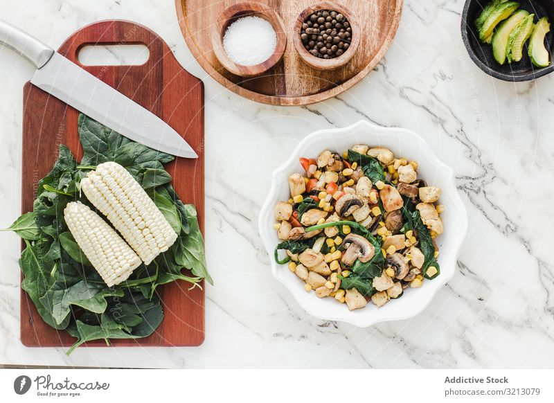 Served chicken with mushrooms corn and greenery delicious served food meal gourmet cuisine nutrition dinner meat spice salad vegetable plate bowl tasty diet