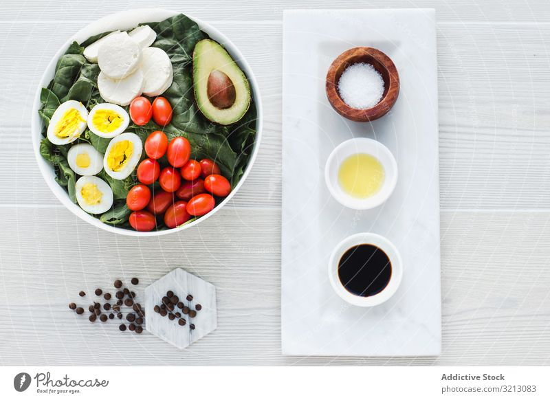 Spinach salad with eggs avocados tomatoes and mozzarella cheese asparagus walnut greenery delicious served food meal gourmet cuisine nutrition dinner spice