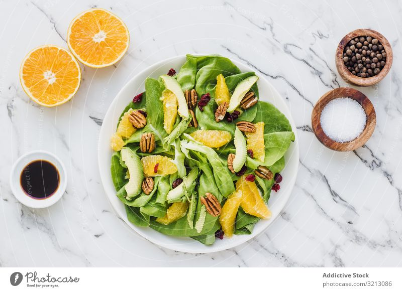 Served avocado and orange with pecan delicious served food meal gourmet cuisine nutrition dinner fruit vegan vegetarian plate bowl tasty diet health nuts dish