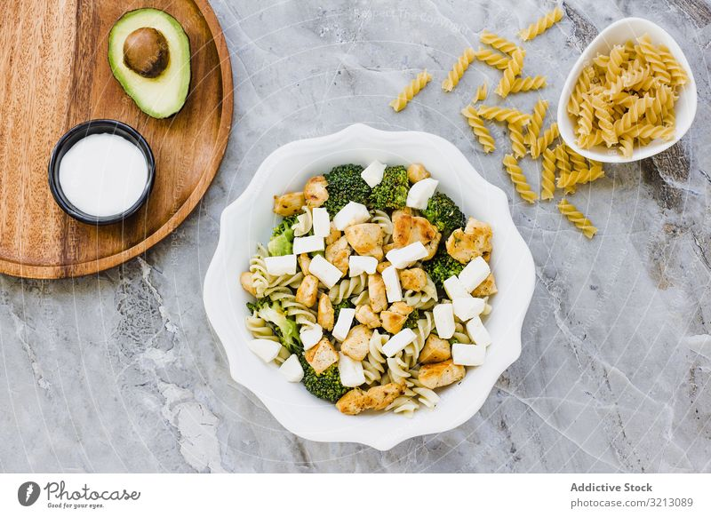 Bowl of cut chicken broccoli macaroni and cheese delicious served food meal gourmet cuisine nutrition dinner meat spice plate bowl tasty diet health dish