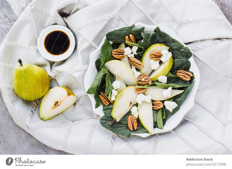 Served pears with pecan and soy sauce delicious served food meal gourmet cuisine nutrition dinner spice fruit vegan vegetarian plate bowl tasty diet health dish