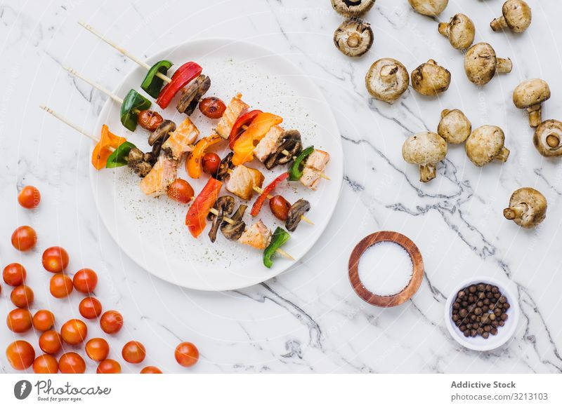 Served salmon cherry tomatoes mushrooms and peppers skewer delicious served food meal gourmet cuisine nutrition fish dinner spice vegetable plate bowl tasty