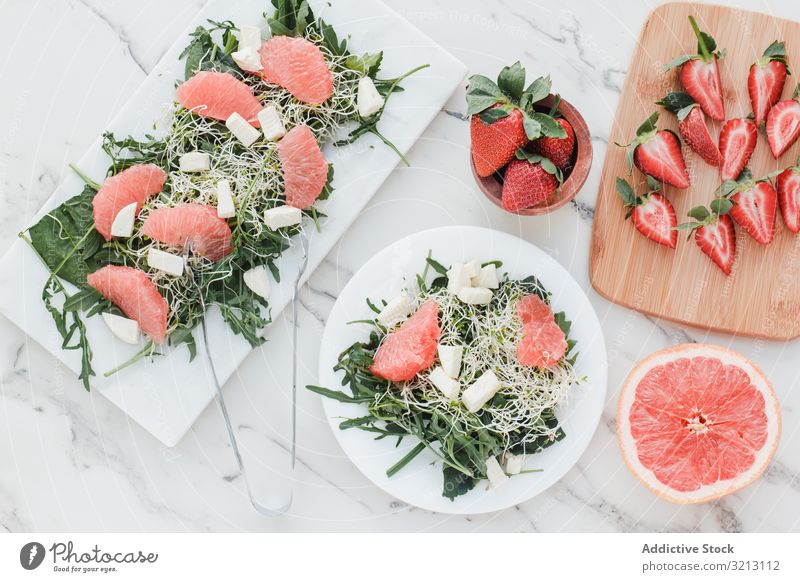 Strawberry, grapefruit and rocket salad on bowl strawberry almond greenery avocado delicious served food meal gourmet cuisine nutrition dinner spice vegetable
