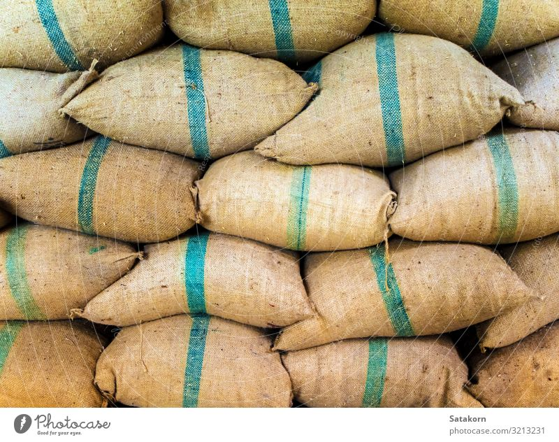 Rice in sacks stacked up a lot Factory Packaging Package Sack Fat Brown Green paddy bulk Storage Stack Warehouse food background wall Consistency agriculture