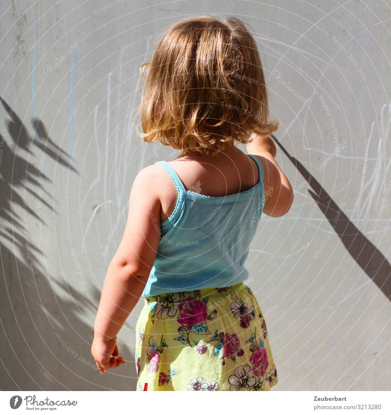 Little girl paints in sunlight on grey wall Feminine Child Girl Infancy 1 Human being 3 - 8 years T-shirt Skirt Blonde Discover Draw Playing Happy Small Cute