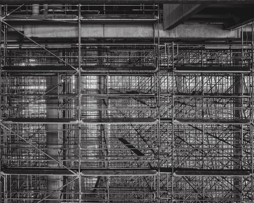 Equipped Deserted High-rise Manmade structures Building Sharp-edged Gigantic Scaffolding Carrier Pipe Wooden board Arrangement Muddled Black & white photo