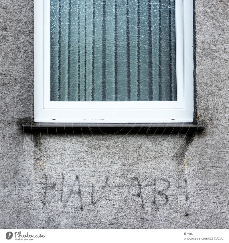 Unloading | Written House (Residential Structure) Wall (barrier) Wall (building) Window Stone Concrete Characters Graffiti Dark Emotions Moody Life Surprise